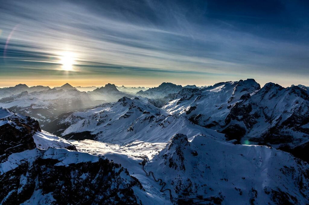 Passo Gardena Dolomites pass road South Tyrol sunrise mountains winter landscape snow aerial view